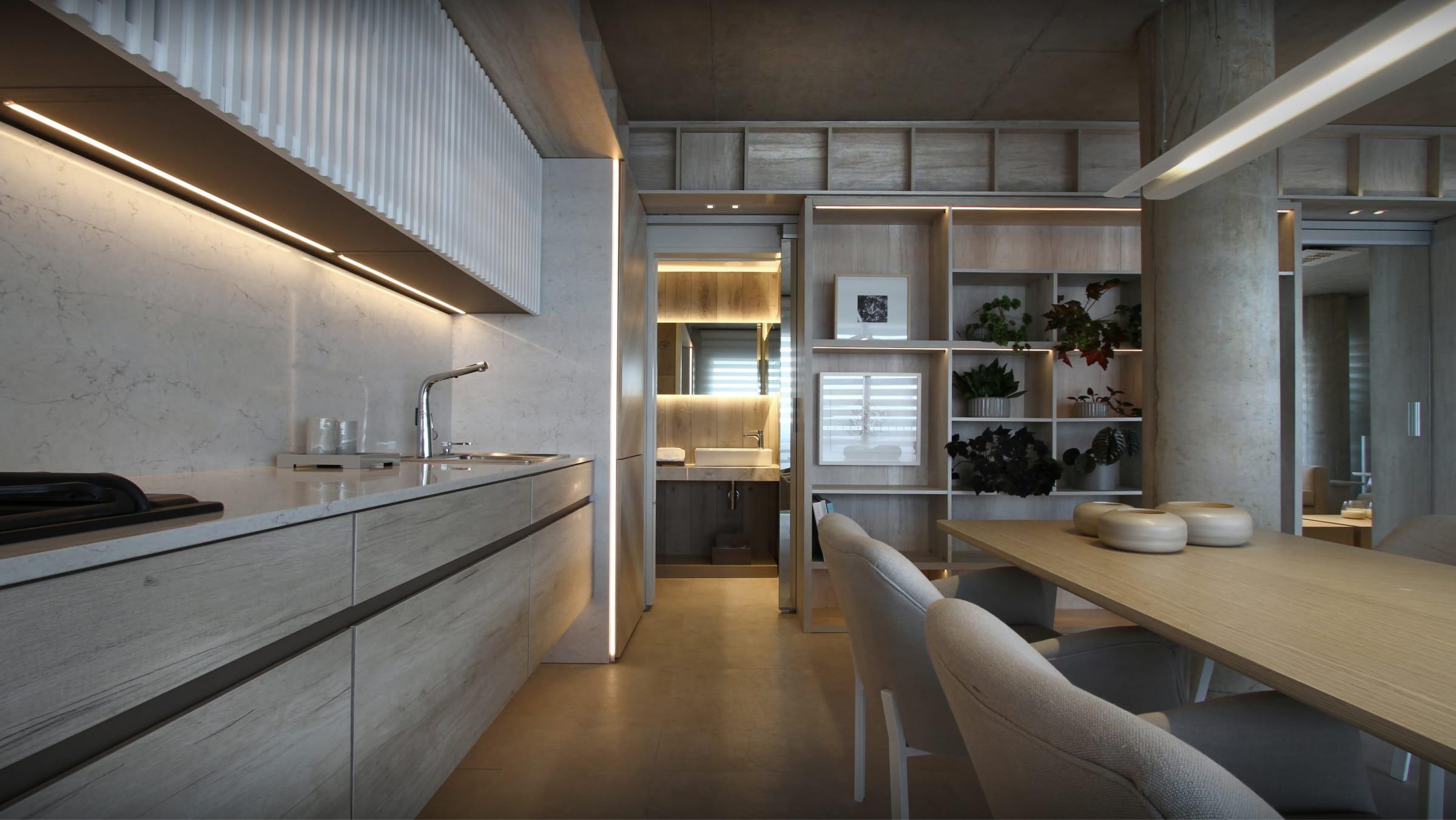 El mismo piso de porcellanato (Vite Porcellanato, colección Cementos) en todos los ambientes colabora a la integración de los espacios
